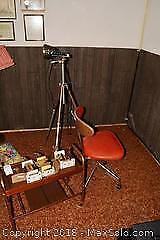 Trophies, Chair And Tripod. A