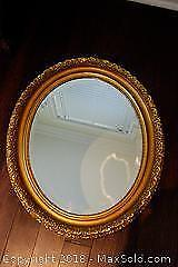 Large gold frame oval mirror