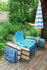 Resin Muskoka Chairs, Table, Foot Rests, Umbrella and cushions. A