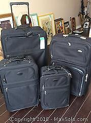FOUR PIECES OF BLACK LUGGAGE-B
