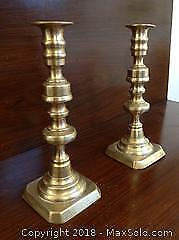 Two TRADITIONAL British candlesticks made of solid brass. Victorian period. Nine inches high.