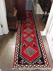 """Tribal mid eastern """"runner"""" for hallway. In geometric patterns in red, black, and ivory. dimensions 113 inches by 27 and"""
