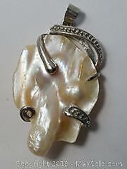 A Mabe Pearl Pendant with Sterling Frame. A Mabe Pearl occurs when the Oyster is opened too soon