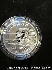 1875 To 2000 Hockey. Sterling Silver 92.5% Silver. 50 Cent Canadian Coin In A Metal Presentation Case.