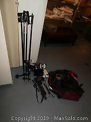 Ski Boots, Poles, Goggles and More. B