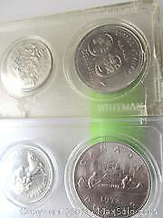 1978 Silver Dollar Canoe Set With A Winnipeg 1874 To 1974 Silver Dollar Set of Canadian Currency Coins.