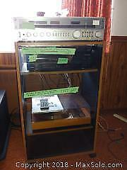Onkyo Amplifier, Panasonic DVD player and Media Cabinet