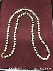 A White Jade Bead Necklace With 14K Gold Clasp