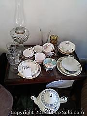 Cups And Saucers And Teapot A