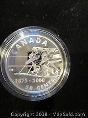1875-2000 Sterling Silver, 50 Cent Canadian Coin In A Metal Presentation Case.
