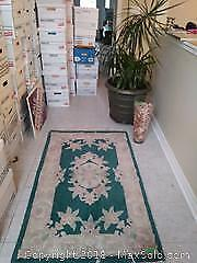 F. Planter Vase And Rugs A