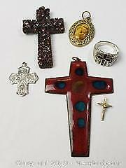 A selection of four crosses, a medal and a Sterling ring with onyx cross marked 925