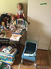 Dolls And Doll Carriage A