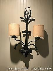 Rustic iron wall sconce