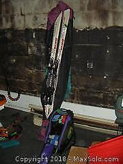 Skis, Boots And Poles A