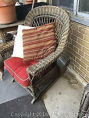 2 wicker rocking chairs with cushions