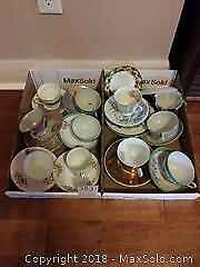Tea Cups and Saucers With Plates A
