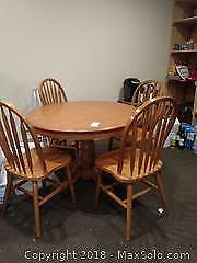 F. Round Pedestal Table And Chairs B