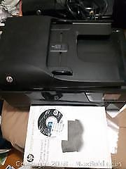 HP Officejet 6600 with manual and CD.