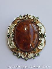 Amber like Pin/Pendant. Unique frame of gold and white with small green stones