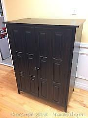 Cabinet - Black - red edging with bi-fold doors - minor wear - sold as is