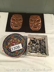 Box Of Souvenir Spoons, Hanging Masks, A tin Of Buttons.