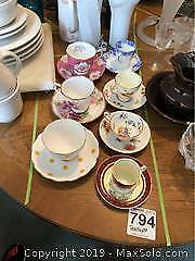 Tea And Espresso Cups And Saucers A