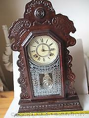 Antique Ansonia Large size Gingerbread Clock With Swing Pendulum. With The Original Key.