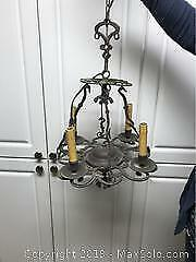 Antique metal chandelier with green accents