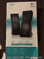 Logitech wired speakers, bluetooth speaker, and other electronics