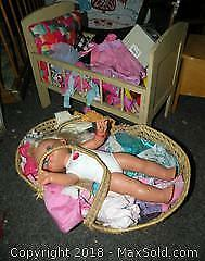 Doll crib doll and different size doll clothes