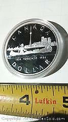 1834 Toronto 1984 Silver Dollar Coin. Depicts Toronto City Skyline With Native In A Canoe.