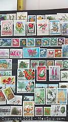 World Stamp Collection In A UNI-SAFE Album.