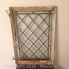 Small, old wall or window decorative piece.