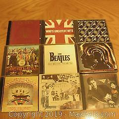 9 CDS, Beatles, Queen, Rolling Stones, The Who.