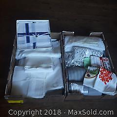 2 Boxes of new and used linens