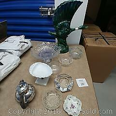 Assortment of glass bowls and cigarette holders and an umbrella stand