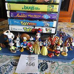 DISNEY- 24 VHS MOVIES WITH STAND AND SMALL FIGURINES