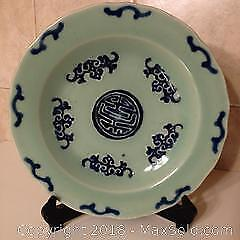 Chinese antique celadon and blue decorated plate.
