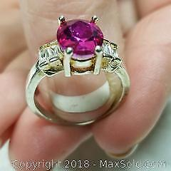 Ladies size 7 + 1/2 Ring with Pink Stone