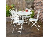 BRAND NEW WROUGHT IRON GARDEN TABLE AND 4 CHAIRS RRP £159.99