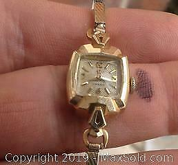 14k gold ladies Omega watch in working condition.