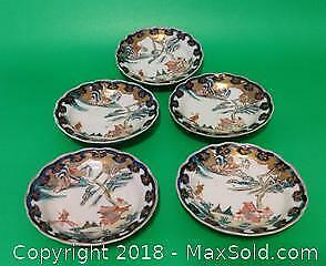 FIVE Asian plates. Each approximately 4 and 1/4 inches in diameter. All hand painted. Each is slightly different in the