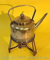 Arts and Crafts solid brass tea kettle on brass stand with heater to base.
