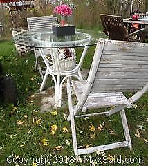 Glass to outside table and 2 folding wood chairs
