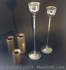 Italian silver plated candlesticks and graduated brass candle-holders