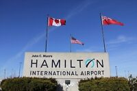 Arrange a drive to Hamilton airport this Saturday for two ppl