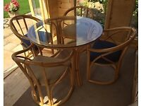 Stunning glass round table and 4 chairs. Angrave furniture