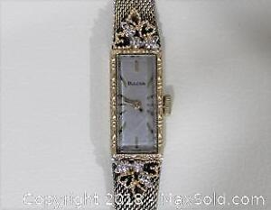 Ladies 14 Karat Gold & Diamond Vintage Bulova Watch
