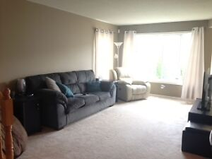 SPACIOUS END UNIT TOWNHOME HAS OVER 1800 SQ FT OF LIVING SPACE